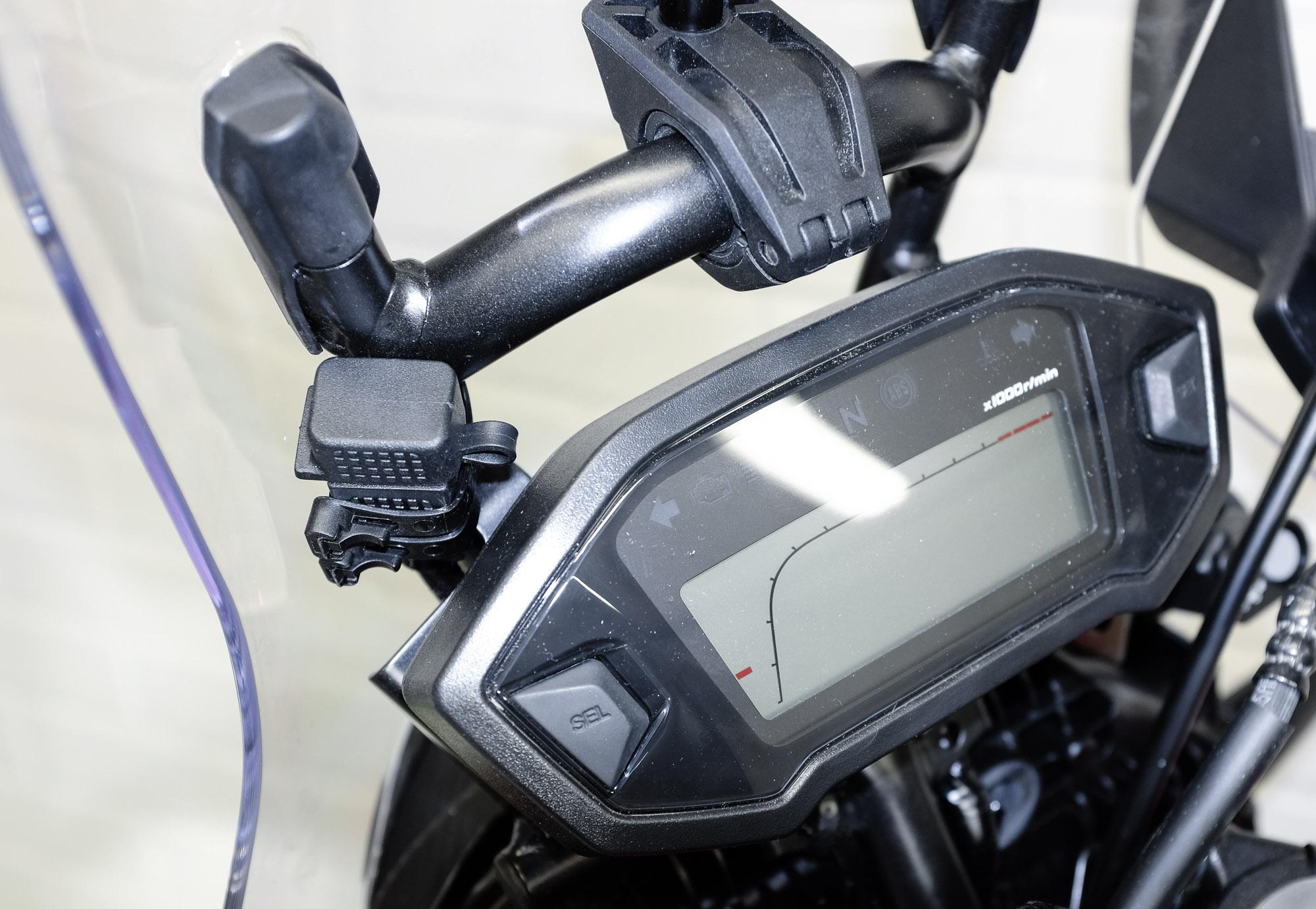 USB charging plug mounted on the GPS bar
