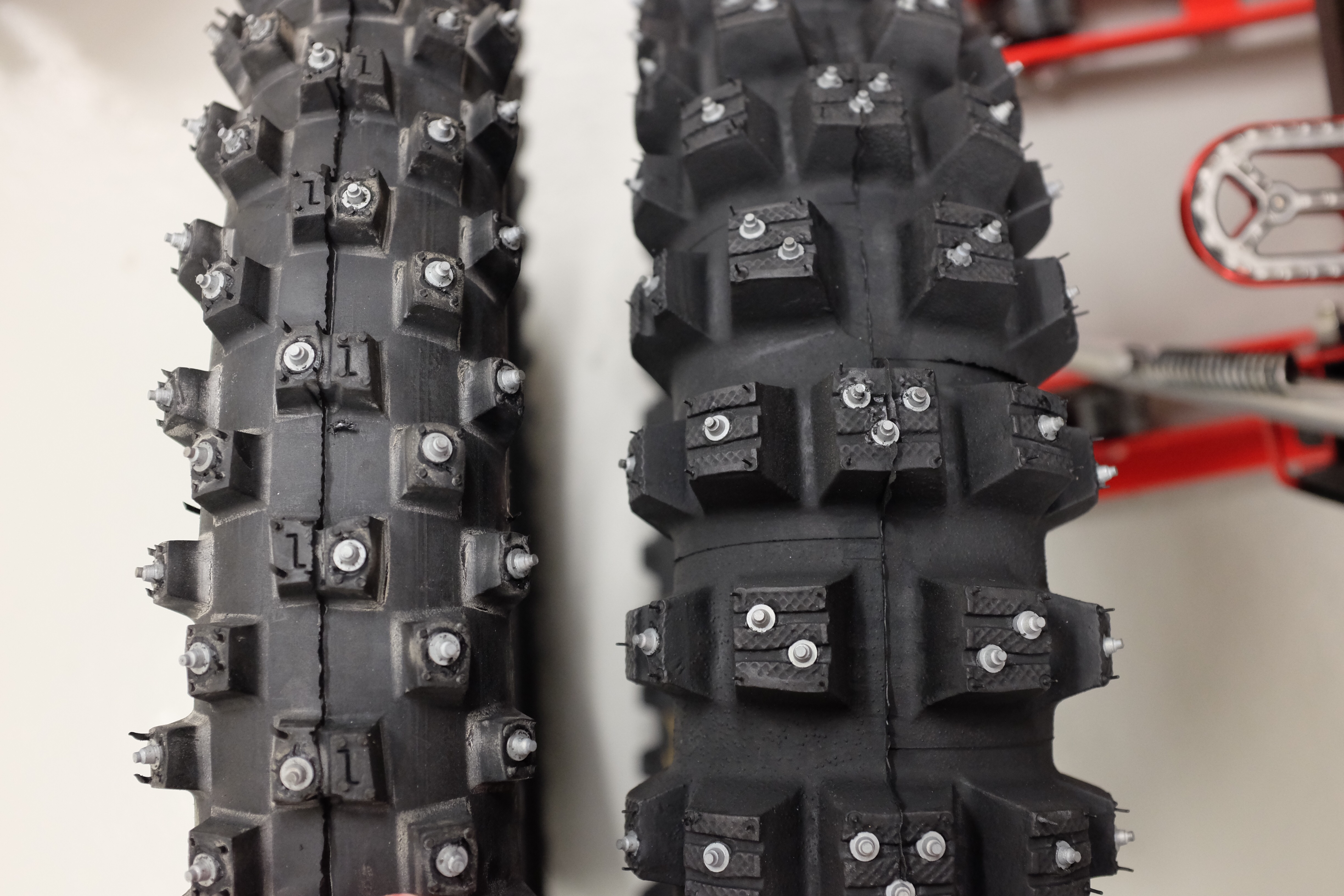 Studded winter tires for Honda CRF 250 Rally. The rear doesn't fit though. Mitas CO2 120/90 -18 rear with studs is too tall to clear the rear swing.
